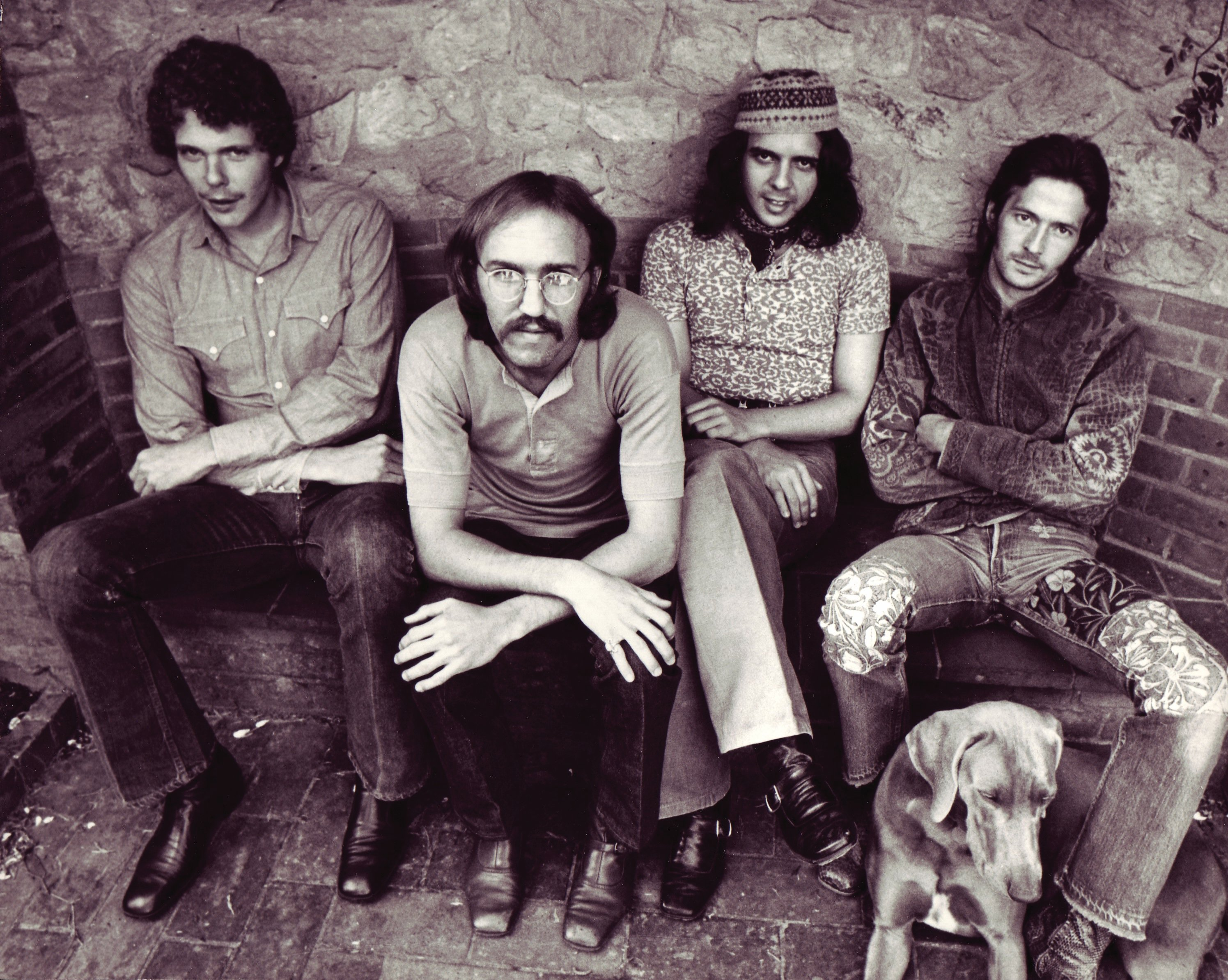 Sitting on Top of the World: Radle, Gordon, Whitlock, Clapton, and four-legged  friend take a break during the Layla sessions. Photo courtesy Polygram Press Archive.
