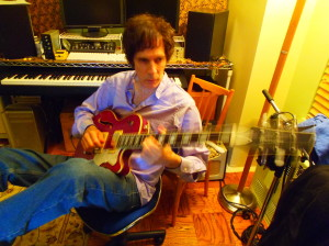 Stickin' Stone: Heyman composing on his Waterstone guitar in his home studio. Photo by Nancy Leigh.