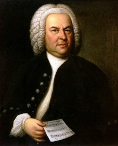 Johann Sebastian Bach, with notes in hand.