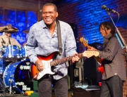 ROBERT CRAY SMILING WITH STRAT - PHOTO BY JAMES L. BASS
